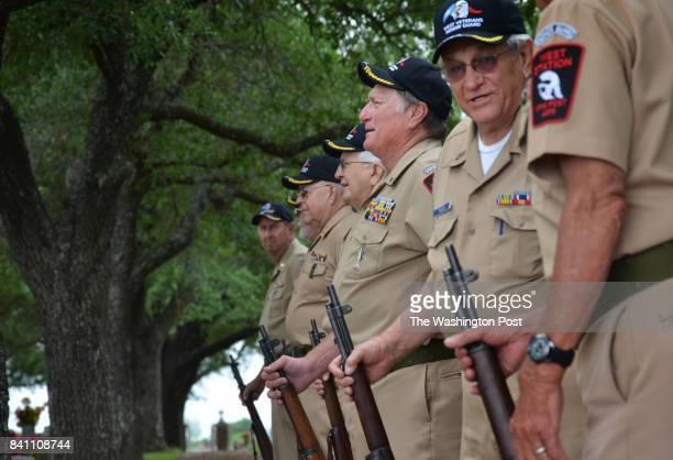 Members of the honor guard of West Texas get into formation at St Marys Cemetery as the body of a World War II veteran arrives for burial in West TX...