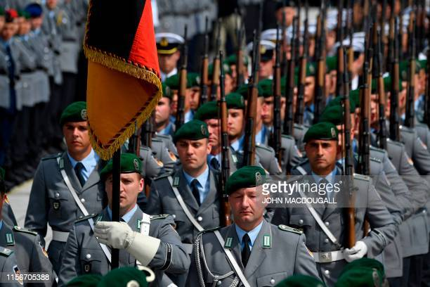 Members of the honor guard parade during a swearingin ceremony of new recruits of German Bundeswehr soldiers at the German Defence Ministry in Berlin...