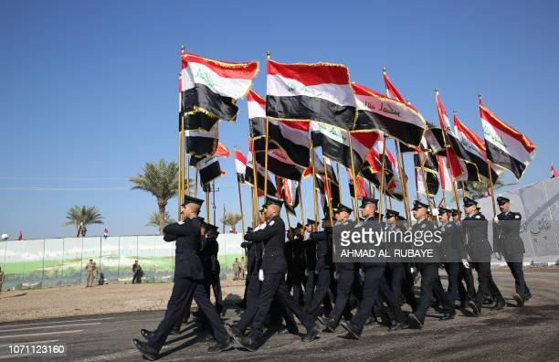 Members of the honour guard of Iraq's Rapid Response military unit take part in a parade at a military base inside Baghdad's International Airport to...