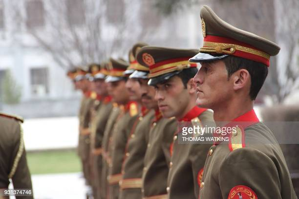 Members of the honour guard stand outside the presidential palace during US Defence Secretary Jim Mattis visit to Afghanistan in Kabul on March 13...