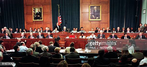 Members of the House Judiciary Committee discuss articles of impeachment against US President Bill Clinton 11 December on Capitol Hill in Washington...
