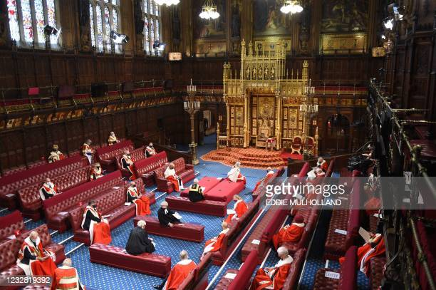 Members of the House of Lords await the arrival of Britain's Queen Elizabeth II, in the House of Lords chamber, during the State Opening of...