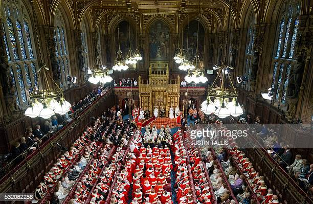 TOPSHOT Members of the House of Lords gather to hear the Queen's Speech in the Chamber at the Houses of Parliament in London on May 18 during State...
