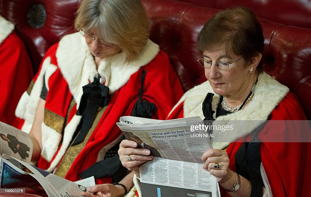 Members of the House of Lords read newspapers as they wait for Britain's Queen Elizabeth II to address the House of Lords, during the State Opening of Parliament, at the Houses of Parliament, in Westminster, central London on May 25, 2010. Britain's Queen Elizabeth II set out the new coalition government's legislative programme on Tuesday in a ceremony of pomp and history following the closest general election for decades. AFP PHOTO/Leon Neal/Pool