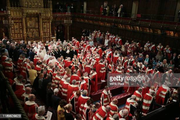 Members of the House of Lords sit in the chamber during the State Opening of Parliament by the Queen in the House of Lords at the Palace of...