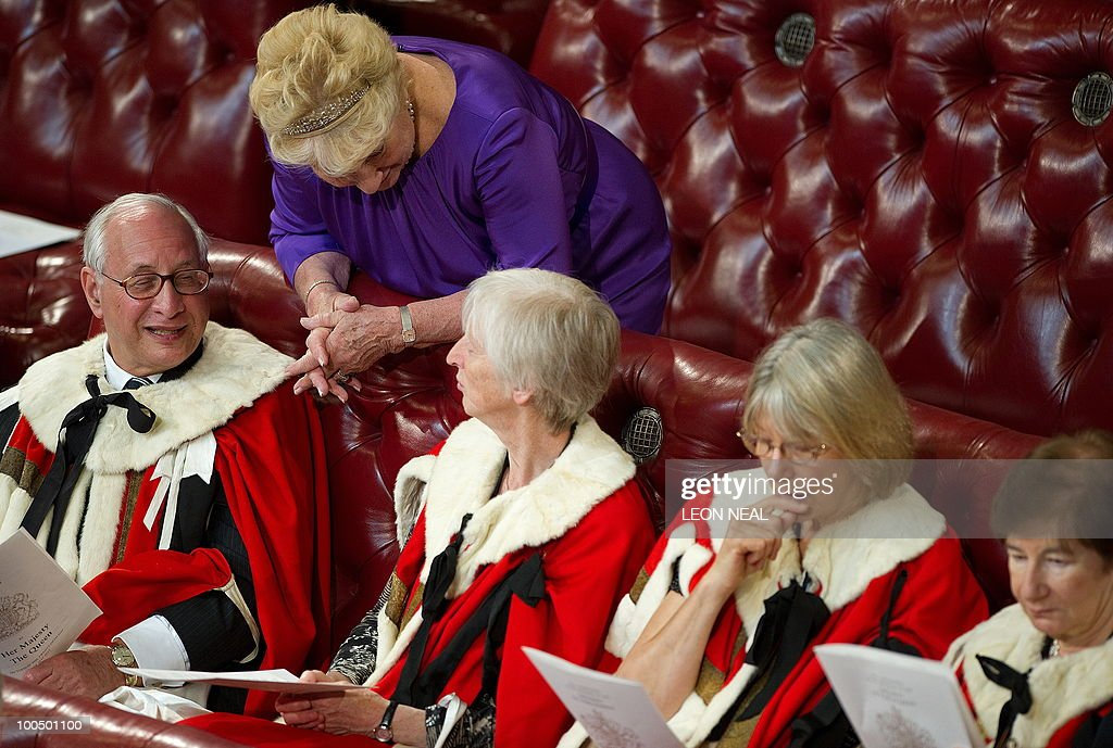 Members of the House of Lords wait for Britain's Queen Elizabeth II to address the House of Lords, during the State Opening of Parliament, at the Houses of Parliament, in Westminster, central London on May 25, 2010. Britain's Queen Elizabeth II set out the new coalition government's legislative programme on Tuesday in a ceremony of pomp and history following the closest general election for decades. AFP PHOTO/Leon Neal/Pool