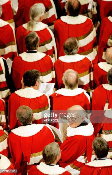 Members of the House of Lords wait for Britain's Queen Elizabeth II to deliver her speech outlining the government's legislative program during the...