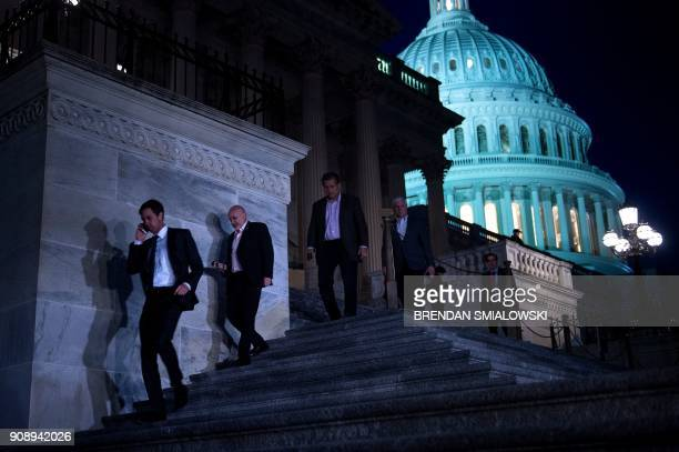TOPSHOT Members of the House of Representatives leave after a vote on Capitol Hill after the House and Senate moved to end a government shutdown on...