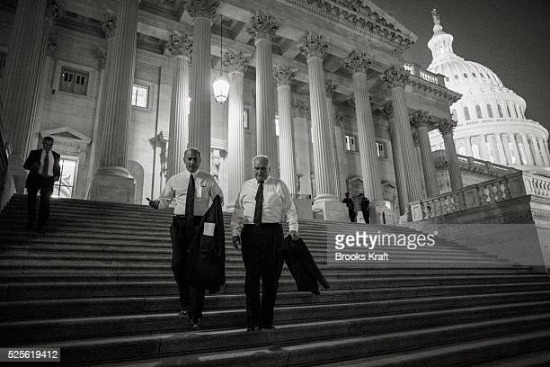 Members of the House of Representatives leave the Capitol after a procedural vote on the impending shutdown of the government set to commence in a...