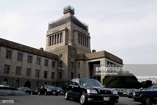 Members of the House of Representatives leave the Parliament Building by car on October 10 2003 in Tokyo Japan Japanese Prime Minister Junichiro...