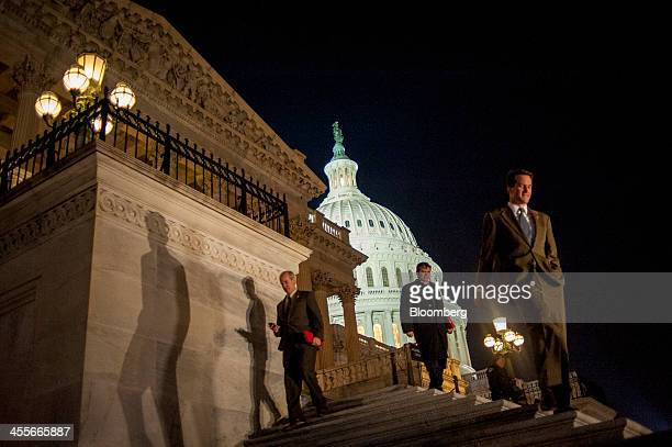 Members of the House of Representatives leave the US Capitol following a budget deal vote in Washington DC US on Thursday Dec 12 2013 The US House...