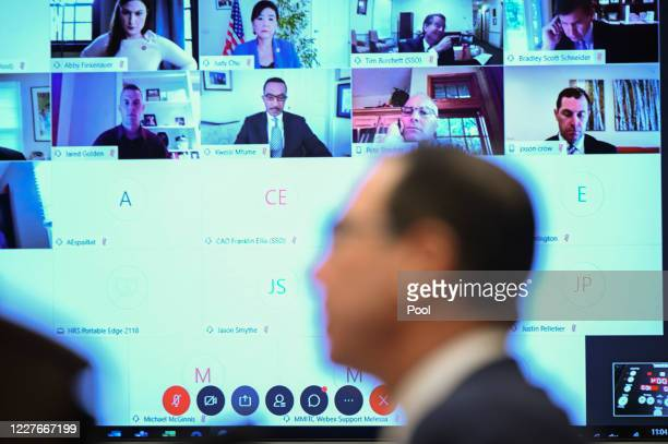 Members of the House Small Business Committee are displayed on a monitor while videoconferencing past Steven Mnuchin, U.S. Treasury secretary,...
