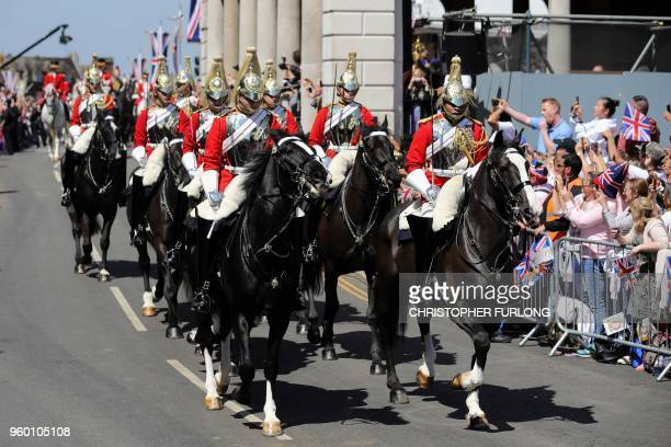 Members of the Household Cavalary lead the procession as Britain's Prince Harry Duke of Sussex and his wife Meghan Duchess of Sussex travel in the...