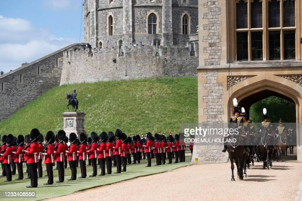 Members of the Household Cavalry arrive as members of the F Company Scots Guards stand to attention as Britain's Queen Elizabeth II attends a...