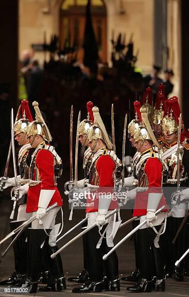 Members of the Household Cavalry arrive outside the Palace of Westminster for the State Opening of Parliament on November 18 2009 in London England...