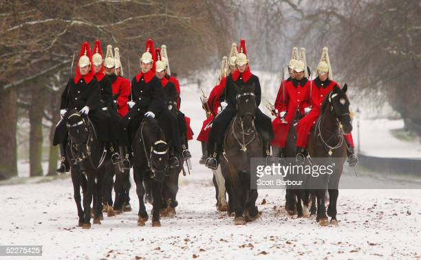 Members of the Household Cavalry exercise their mounts in the snow through Hyde Park on March 4 2005 in London England Schools have been forced to...