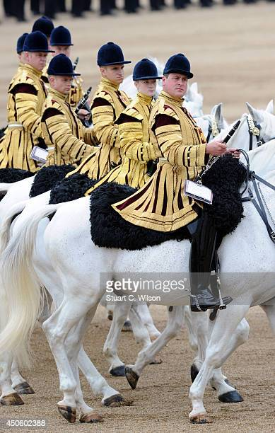 Members of the Household Cavalry march past Queen Elizabeth II during Trooping the Colour at The Royal Horseguards on June 14 2014 in London England