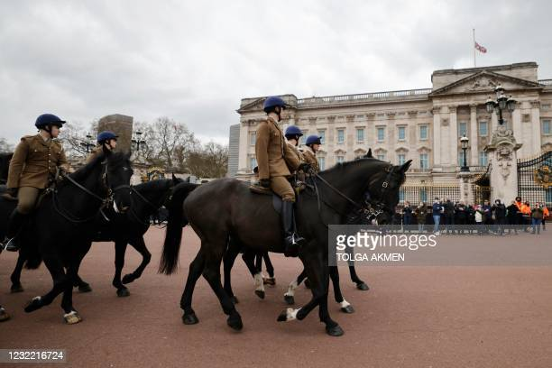 Members of the Household Cavalry mark the passing of Britain's Prince Philip, Duke of Edinburgh as they ride past Buckingham Palace, central London...