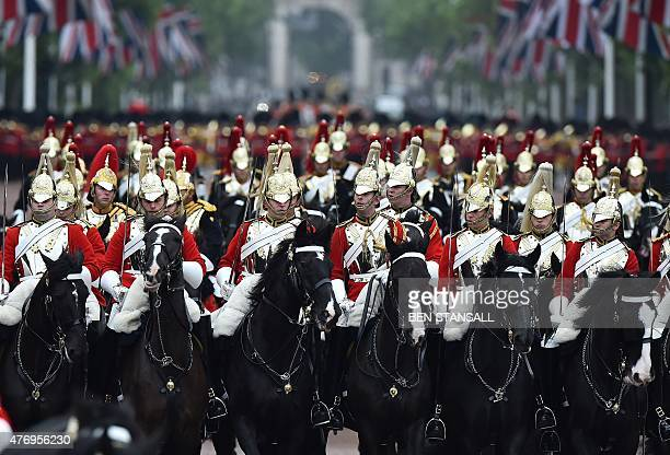 Members of the Household Cavalry Mounted Regiment process along the Mall to Buckingham Palace from Horse Guards Parade during the Queen's Birthday...