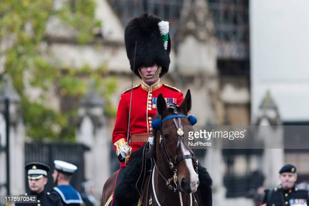 A members of the Household Cavalry Mounted Regiment rides a horse during the State Opening of Parliament on 14 October 2019 in London England