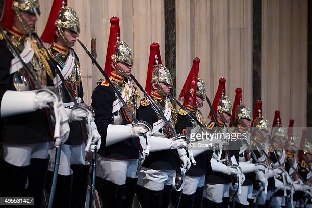 Members of the Household Cavalry stand guard in the Norman Porch of the Palace of Westminster prior to the State Opening of Parliament on June 4 2014...