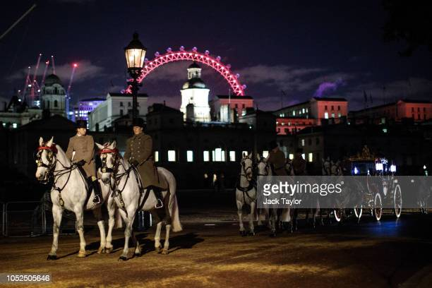Members of the Household Division including the Royal Carriage Procession take part in a process from Horse Guards Parade as they rehearse their...
