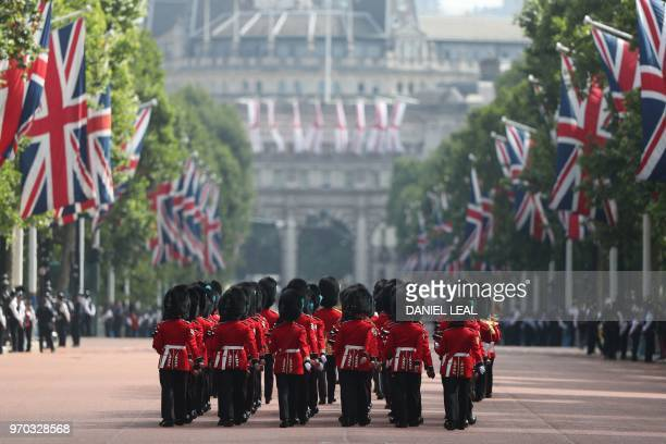 TOPSHOT Members of the Household Division march down The Mall to Horseguards parade ahead of the Queen's Birthday Parade 'Trooping the Colour' in...