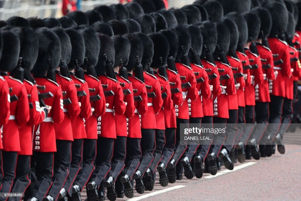 TOPSHOT - Members of the Household Division, march to Horseguards parade ahead of the Queen's Birthday Parade, 'Trooping the Colour', in London on June 9, 2018. - The ceremony of Trooping the Colour is believed to have first been performed during the reign of King Charles II. In 1748, it was decided that the parade would be used to mark the official birthday of the Sovereign. More than 600 guardsmen and cavalry make up the parade, a celebration of the Sovereign's official birthday, although the Queen's actual birthday is on 21 April.