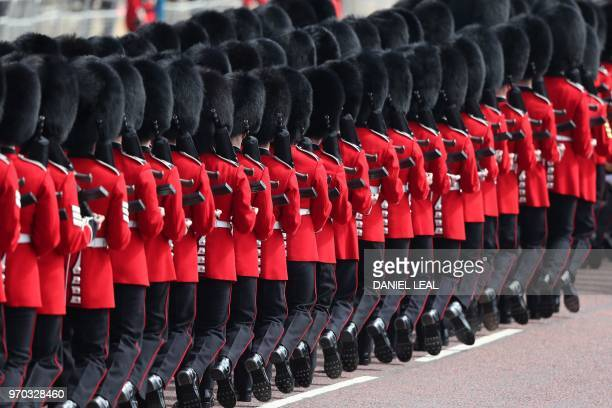 TOPSHOT Members of the Household Division march to Horseguards parade ahead of the Queen's Birthday Parade 'Trooping the Colour' in London on June 9...