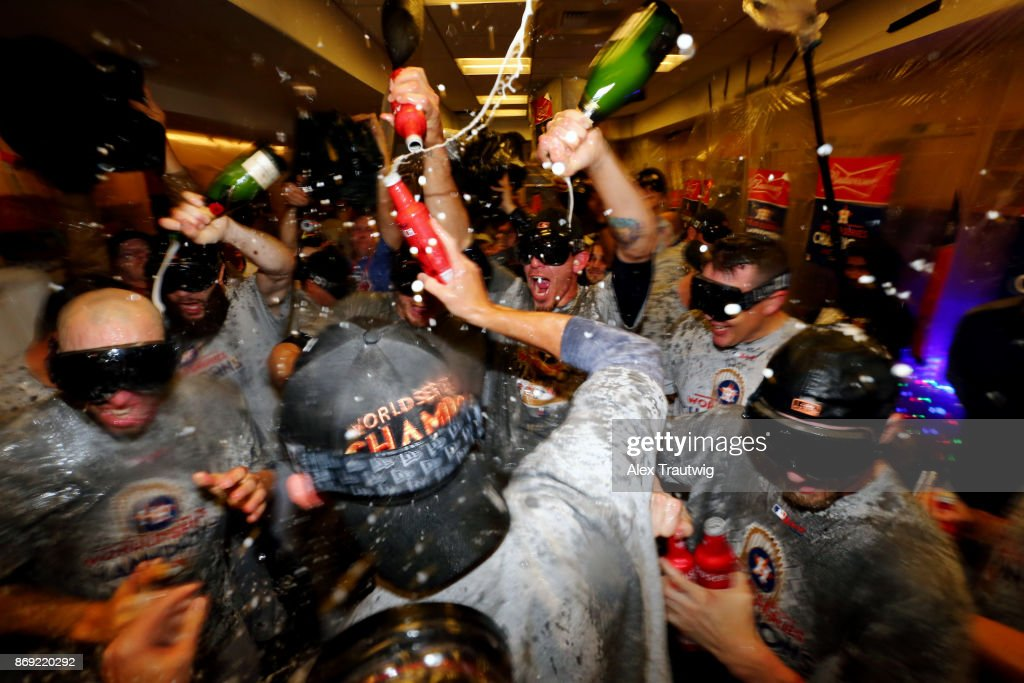 Members of the Houston Astros celebrate in the clubhouse