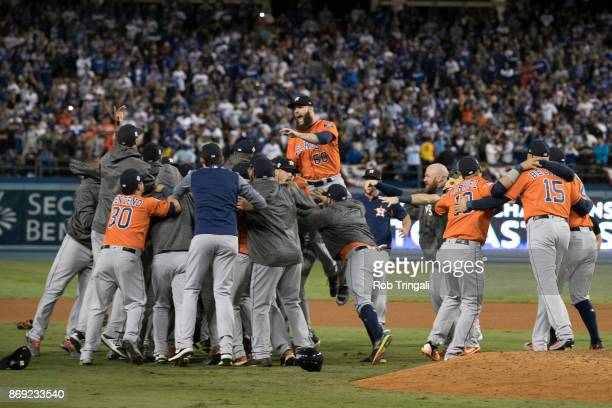 Members of the Houston Astros celebrate on the field after the Astros defeated the Los Angeles Dodgers in Game 7 of the 2017 World Series at Dodger...