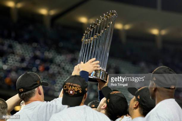 Members of the Houston Astros hoist the Commissioner's Trophy after defeating the Los Angeles Dodgers in Game 7 of the 2017 World Series at Dodger...