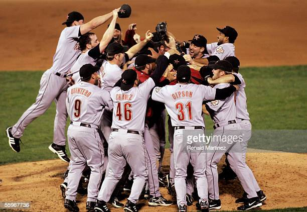 Members of the Houston Astros pile up on each other after they defeated the St Louis Cardinals 51 in Game Six of the National League Championship...