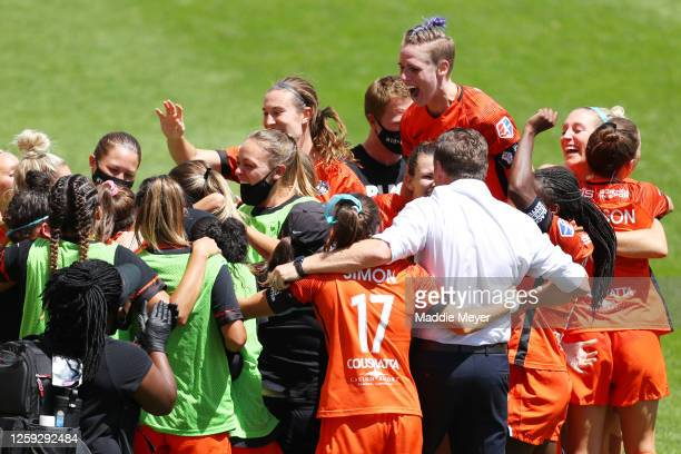Members of the Houston Dash celebrate after Shea Groom scored a goal in the 91st minute against Alyssa Naeher of Chicago Red Stars during the second...