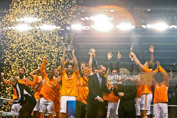 Members of the Houston Dynamo celebrate their victory over Sporting Kansas City after the MLS Eastern Conference Championship match at Livestrong...