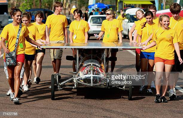 Members of the Houston High School Solar Car Race Team from the United States prepare their entry for a qualifying lap at the World Solar Challenge...
