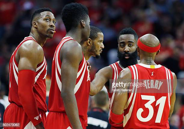 Members of the Houston Rockets huddle on the court during their game against the San Antonio Spurs at the Toyota Center on December 25 2015 in...