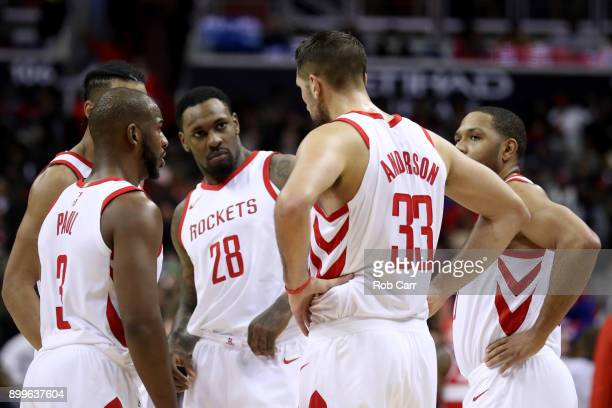 Members of the Houston Rockets talk on the floor before the start of the fourth quarter against the Washington Wizards at Capital One Arena on...