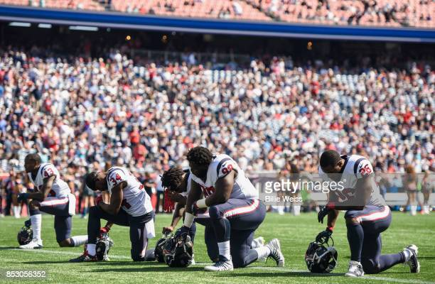Members of the Houston Texans kneel before a game against the New England Patriots at Gillette Stadium on September 24 2017 in Foxboro Massachusetts