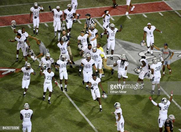 Members of the Howard Bison celebrate as time expires in their 4340 win over the UNLV Rebels at Sam Boyd Stadium on September 2 2017 in Las Vegas...