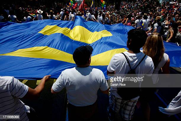 Members of the Human Rights Campaign carry their flag during 43rd annual San Francisco Lesbian, Gay, Bisexual, Transgender Pride Celebration & Parade...