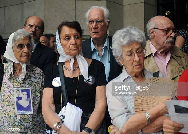 Members of the Human Rights organization Madres de Plaza de Mayo stand next to Argentinian actor Federico Luppi on January 30 2012 in Buenos Aires...