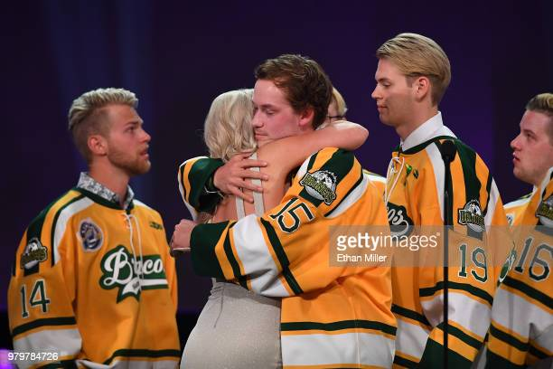 Members of the Humboldt Broncos hug Christina Haugan wife of Humboldt Broncos coach Darcy Haugan after accepting the Willie O'Ree Community Hero...