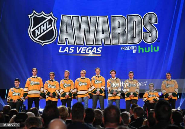 Members of the Humboldt Broncos junior hockey league team stand onstage during the 2018 NHL Awards presented by Hulu at The Joint inside the Hard...