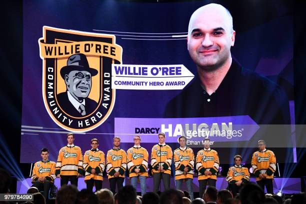 Members of the Humboldt Broncos stand onstage as Darcy Haugan is presented with the Willie O'Ree Community Hero Award at the 2018 NHL Awards...