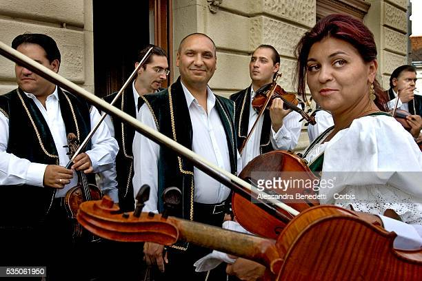 Members of the hungarian gipsy ensemble 'Rajko Zenekar' prepare to perform in BudapestThe Rajko Gypsy Ensemble was established in 1952 by Gyula...