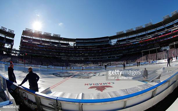 Members of the ice crew manage the ice surface during practice day prior to the 2015 Bridgestone NHL Winter Classic on December 31 2014 in Washington...
