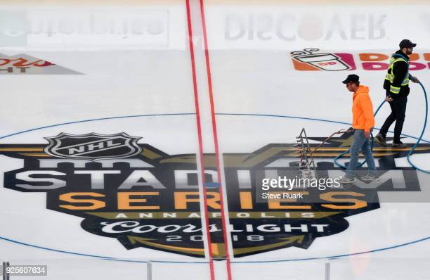 Members of the ice crew prepare an ice rink at NavyMarine Corps Memorial Stadium for the 2018 Coors Light NHL Stadium Series game on February 28 2018...