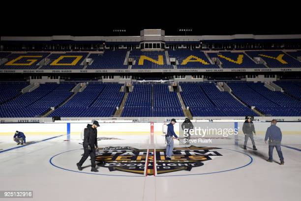 Members of the ice crew prepare NavyMarine Corps Memorial Stadium for the 2018 Coors Light NHL Stadium Series game on February 27 2018 in Annapolis...
