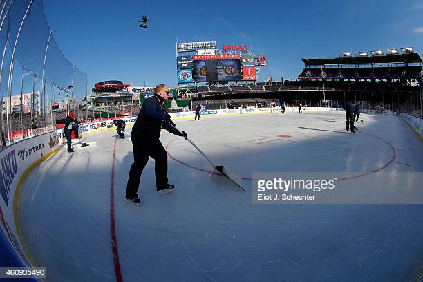 Members of the ice crew shovel the ice surface during practice day prior to the 2015 Bridgestone NHL Winter Classic on December 31 2014 in Washington...